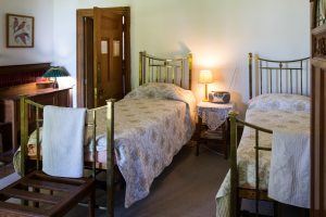 Matching brass bedsteads, beautiful linen and tasteful furnishings in our twin room.